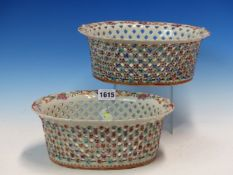A PAIR OF CHINESE EXPORT BASKETS, THE WAVY RIMS GILT WITH BAMBOO ALTERNATING WITH FAMILLE ROSE