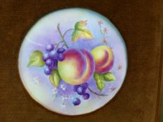 A GOLD FRAMED PORCELAIN ROUNDEL PAINTED WITH PEACHES AND GRAPES BY FRANCIS CLARK. Dia. 13cms.