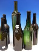 FOUR GREEN GLASS BOTTLES AND TWO BROWN, THREE OF THE FORMER WITH SEALS READING LPG, CHATEAU