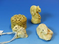 A CHINESE RELIEF CARVED IVORY BOX CONTAINING EIGHT MOTHER OF PEARL COUNTERS. Dia. 3.5cms.TWO RAT