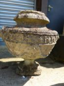 A SET OF FOUR CLASSICAL STYLE SWAG DECORATED COMPOSITE STONE GARDEN URNS, H 55cms.