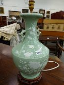A CHINESE CELADON GROUND TWO HANDLED BOTTLE VASE AS A LAMP, THE BODY DECORATED IN WHITE WITH BATS,