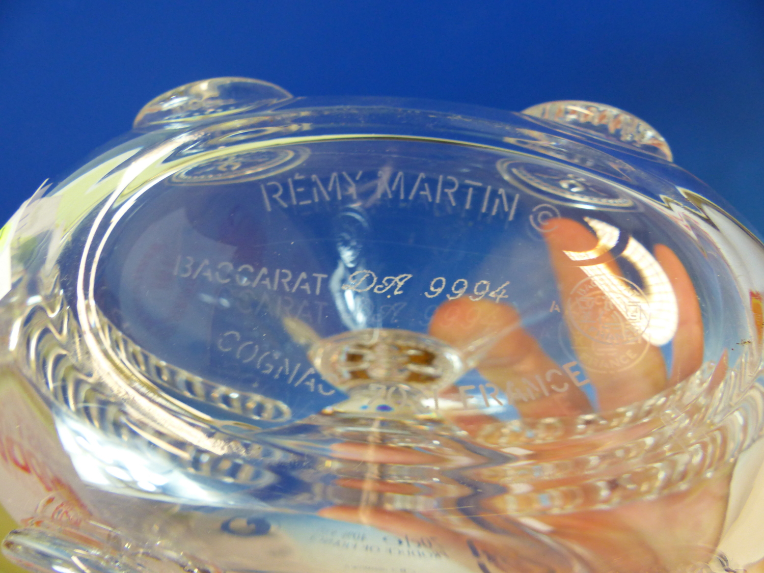 Lot 1768 - A 1994 BACCARAT REMY MARTIN LOUIS XII CHAMPAGNE CONGNAC FLASK MOULDED WITH FLEUR DE LYS ROUNDELS,