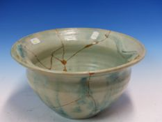 AN EARLY CARTER, POOLE POTTERY BOWL GLAZED IN TONES OF TURQUOISE AND GREY, THE INSIDE RIM MOULDED IN