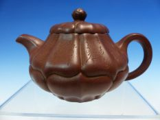 A YIXING TEA POT, TWO OTHERS CHINESE AND AN ENGLISH TREACLE WARE TEA POT, THREE CHINESE BLUE AND