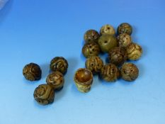 SIXTEEN CHINESE BLACK TINGED GREY HARDSTONE BEADS, THE BROCADE BALL SHAPES CARVED WITH SHOU
