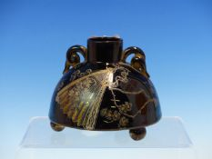 AN AESTHETIC TWO HANDLED DOMED VASE IN CHRISTOPHER DRESSER TASTE, THE BLACK GLAZE PRINTED IN GOLD