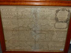 AFTER EMANUEL BOWEN. AN ANTIQUE HAND COLOURED FOLDING MAP OF SHROPSHIRE, NOW MOUNTED IN A MAPLE