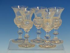 A SET OF FIVE THISTLE SHAPED WHISKY GLASSES WITH THE SIXTH FORMING THE STOPPER TO AN INVERTED