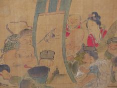A JAPANESE WATERCOLOUR OF THE SEVEN GODS OF GOOD FORTUNE ADMIRING A SCROLL PAINTING TOGETHER WITH