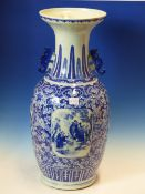 A CHINESE BLUE AND WHITE TWIN HANDLE BALUSTER VASE, PANELS OF FIGURES AND LANDSCAPES AMIDST FOLIAGE.
