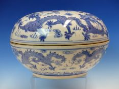 A CHINESE BLUE AND WHITE BOX AND COVER, THE BUN SHAPE DECORATED WITH DRAGONS CHASING FLAMING PEARLS,