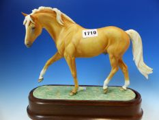 A 1971 ROYAL WORCESTER PALOMINO STALLION MODELLED BY DORIS LINDNER. W 31cms.