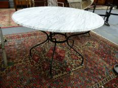 A WROUGHT IRON BASED MARBLE TOPPED CENTRE TABLE. Dia.124 x H.76cms.