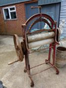 A VINTAGE CAST IRON MANGLE.