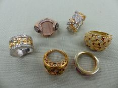 A GROUP OF SIX SILVER GILT AND GEM SET RINGS, FINGER SIZE RANGE L-M 1/2. GROSS WEIGHT 42.9grms.