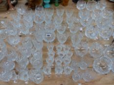 A PART SUITE OF CUT GLASSWARE AND TWO FRUIT BOWLS.
