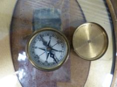 THREE SMALL DESK CLOCKS, TWO ITLIANATE FRAMES, A POCKET COMPASS, FIELD MICROSCOPE ETC.