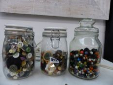 THREE JARS OF ASSORTED BUTTONS AND BEADS.