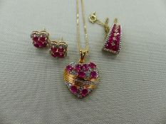 A GROUP OF THREE SILVER GILT AND GEMSET PIECES, TO INCLUDE A HEART PENDANT AND CHAIN, A PAIR OF