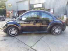 A 2002 VOLKSWAGON BEETLE, 1.6 PETROL, LOW MILEAGE AND MOT.