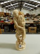 A LARGE JAPANESE 19TH C. CARVED IVORY FIGURE OF A FISHERMAN HOLDING A NET OVER HIS BACK. H. 46cms.