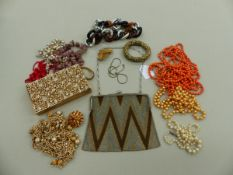 COSTUME JEWELLERY TO INCLUDE BEADS AND BROOCHES, AN ELEGANCE EVANS GILDED EVENING CLUTCH, AND A