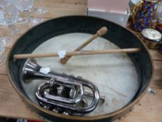 A SILVER PLATED CORNET, AND A BHODRUM DRUM.