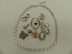 A LARGE SILVER HALLMARKED HORSESHOE, AN 800 SILVER PORTRAIT BROOCH,TWO SILVER RINGS, A SILVER