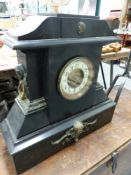 A VICTORIAN SLATE LARGE MANTLE CLOCK AND A WROUGHT IRON ADJUSTABLE CANDLE STAND.