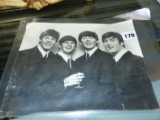 A BEATLES FAN CLUB AUTO SIGNED PHOTOGRAPH.