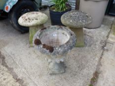A PAIR OF STADDLE STONE AND A GARDEN URN.