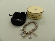 A LINKS OF LONDON SILVER SWEETIE BRACELET COMPLETE WITH FIVE ASSORTED LINKS OF LONDON CHARMS,