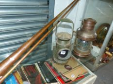 A COPPER MAST HEAD SHIPS LAMP, A MILITARY SIGNALMAN'S RAILWAY LAMP AND TWO COACHING HORNS.
