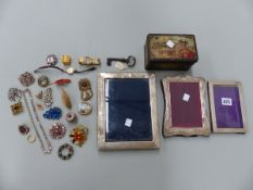THREE HALLMARKED SILVER PHOTOGRAPH FRAMES, MISC. COSTUME JEWELLERY BROOCHES ETC.