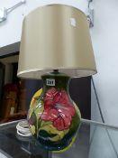 A MOORCROFT TABLE LAMP.