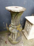 A CARVED STONE BIRDBATH/SUNDIAL BASE.