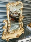 A DECORATIVE DRESSING TABLE MIRROR.