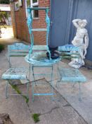 A PAINTED PATIO TABLE AND CHAIRS TOGETHER WITH A JARDINIERE STAND AND A BOOT SCRAPER.