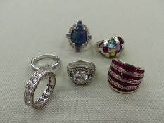 A GROUP OF SIX SILVER AND GEMSET RINGS. FINGER SIZES L. GROSS WEIGHT 46.7grms.