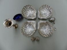 A SET OF FOUR HALLMARKED SILVER PIERCED SHELL FORM DISHES AND A WHITE METAL EGG FORM BOX, TWO