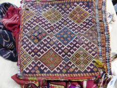 A SMALL ANTIQUE CAUCASIAN FLAT WEAVE BAG, TOGETHER WITH OTHER EASTERN TRIBAL SILK AND EMBROIDERED