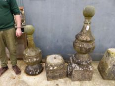 A PAIR OF LARGE CARVED STONE FINIALS WITH BALL KNOPS.