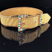 A 9ct GOLD MILANESE STYLE BRACELET WITH BUCKLE FASTENING SET WITH SEED PEARLS AND TURQUOISE.