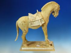 AN EARLY CHINESE POTTERY FIGURE OF A HORSE WITH SADDLE, POSSIBLY TANG DYNASTY. H. 33cm.