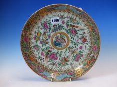 A 19th C. CANTON DISH, THE CENTRAL GOLD FRAMED ROUNDEL ENCLOSED BY BIRDS, BUTTERFLIES AND FLOWERS,