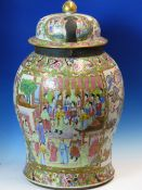 A 19th C. CANTON COVERED JAR, THE BALUSTER BODY PAINTED WITH TWO RESERVES OF FIGURES AGAINST A