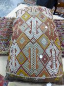 TRIBAL FLAT WEAVE SADDLE BAG MOUNTED AS A CUSHION. LENGTH OVERALL 124cm, TOGETHER WITH ANOTHER