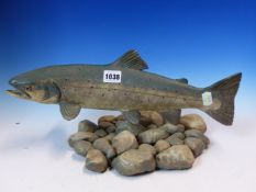 A 1985 POTTERY MODEL OF A SEAT TROUT SWIMMING OVER PEBBLES, SIGNED BY NEIL DALRYMPLE. W 41cms.