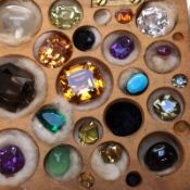 A COLLECTION OF NAIVELY CASED VARIOUS GEMSTONES AND MINERALS.